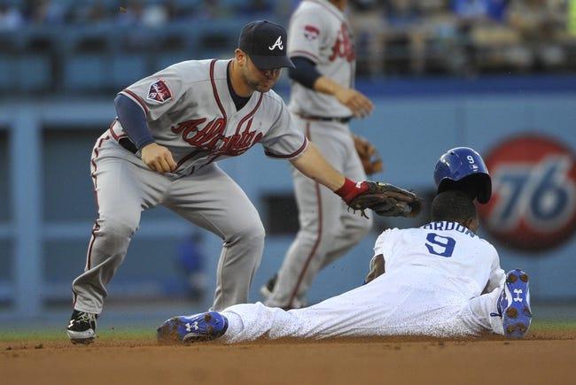 Jul 31, 2014; Los Angeles, CA, USA; Atlanta Braves second baseman Tommy La Stella (7) tags out Los Angeles Dodgers second baseman Dee Gordon (9) on a steal attempt in the 1st inning at Dodger Stadium. Mandatory Credit: Robert Hanashiro-USA TODAY Sports