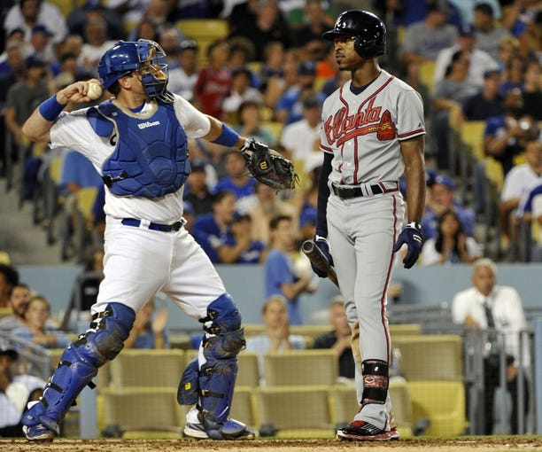 Jul 31, 2014; Los Angeles, CA, USA; Atlanta Braves center fielder B.J. Upton (2) reacts to a called 3rd strike in the 6th inning against Los Angeles Dodgers starting pitcher Clayton Kershaw at Dodger Stadium. Mandatory Credit: Robert Hanashiro-USA TODAY Sports