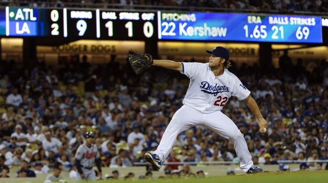 Jul 31, 2014; Los Angeles, CA, USA; Los Angeles Dodgers starting pitcher Clayton Kershaw (22) throws in the 9th inning in the Dodgers 2-1 win over the Atlanta Braves at Dodger Stadium. Kershaw had a complete game as the Dodgers won their 6th game in a row. Mandatory Credit: Robert Hanashiro-USA TODAY Sports