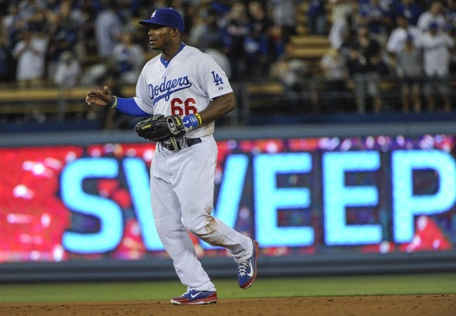 Jul 31, 2014; Los Angeles, CA, USA; Los Angeles Dodgers right fielder Yasiel Puig (66) jogs in from center field at the end of the Dodgers 2-1 win over the Atlanta Braves at Dodger Stadium. The Dodgers won their 6th in the row, Puig scored both Dodger runs. Mandatory Credit: Robert Hanashiro-USA TODAY Sports