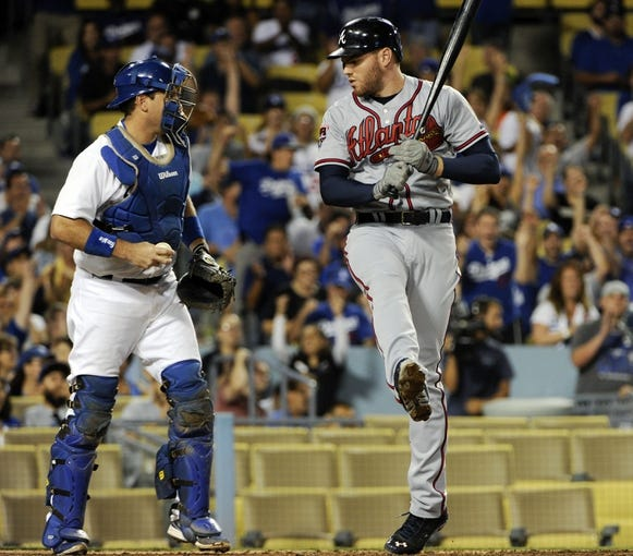 Jul 31, 2014; Los Angeles, CA, USA; Atlanta Braves first baseman Freddie Freeman (5) strikes out swinging in the 9th inning with two runners on base against the Los Angeles Dodgers at Dodger Stadium. The Braves lost 2-1 and were swept in the 3-game series. Mandatory Credit: Robert Hanashiro-USA TODAY Sports