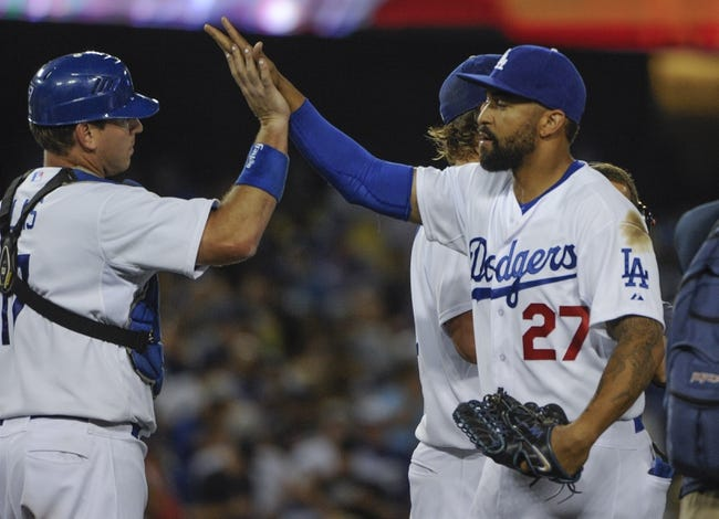 Jul 31, 2014; Los Angeles, CA, USA; Los Angeles Dodgers left fielder Matt Kemp (27) high-fives teammate catcher A.J. Ellis (17) at the conclusion of the Dodgers 2-1 win over the Atlanta Braves at Dodger Stadium. The win was the Dodgers 6th in a row. Mandatory Credit: Robert Hanashiro-USA TODAY Sports