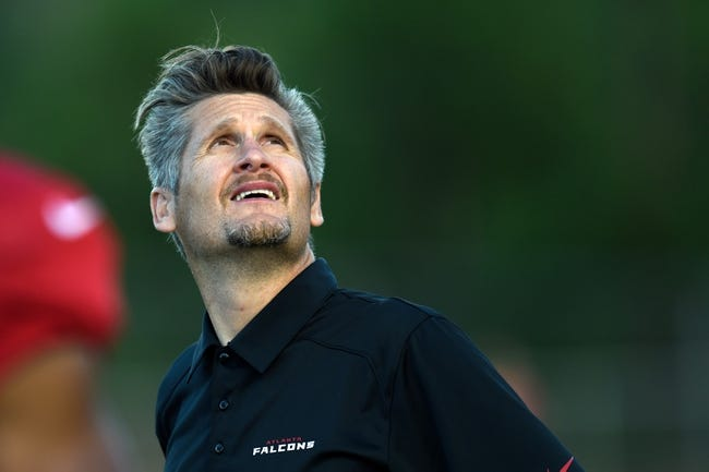 Aug 1, 2014; Lawrenceville, GA, USA; Atlanta Falcons general manager Thomas Dimitroff  watches skydivers land on the field during Atlanta Falcons practice during Falcons Friday Night Lights at Archer High School. Mandatory Credit: Dale Zanine-USA TODAY Sports