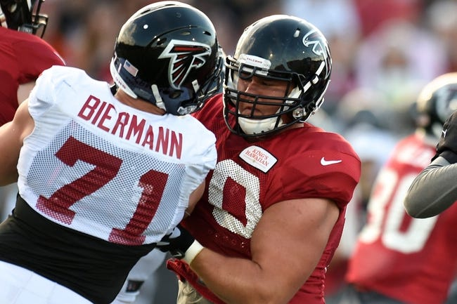 Aug 1, 2014; Lawrenceville, GA, USA; Atlanta Falcons offensive tackle Jake Matthews (70) blocks defensive end Kroy Biermann (71) during practice during Falcons Friday Night Lights at Archer High School. Mandatory Credit: Dale Zanine-USA TODAY Sports