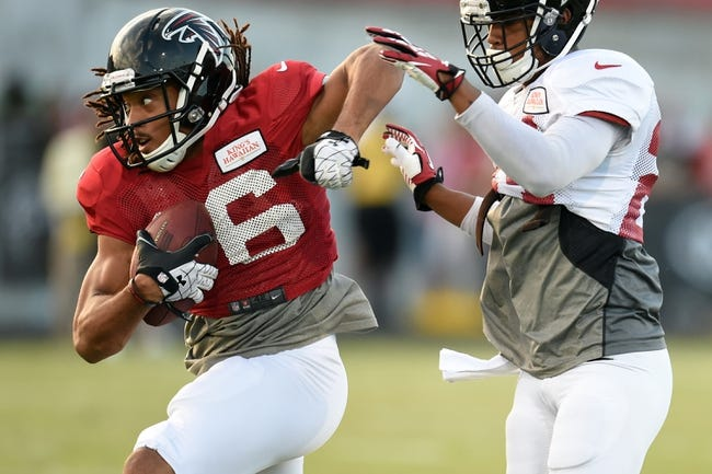 Aug 1, 2014; Lawrenceville, GA, USA; Atlanta Falcons wide receiver Julian Jones (16) works against cornerback Robert Alford (23) during practice during Falcons Friday Night Lights at Archer High School. Mandatory Credit: Dale Zanine-USA TODAY Sports