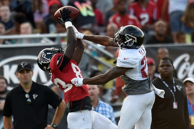 Aug 1, 2014; Lawrenceville, GA, USA; Atlanta Falcons wide receiver Harry Douglas (83) catches a pass against cornerback Robert Alford (23) during practice during Falcons Friday Night Lights at Archer High School. Mandatory Credit: Dale Zanine-USA TODAY Sports