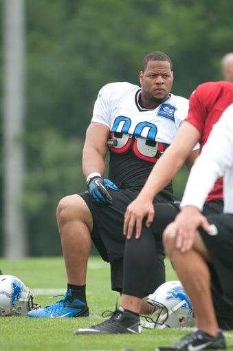Aug 2, 2014; Detroit, MI, USA; Detroit Lions defensive tackle Ndamukong Suh (90) during training camp at the Lions training facility. Mandatory Credit: Tim Fuller-USA TODAY Sports