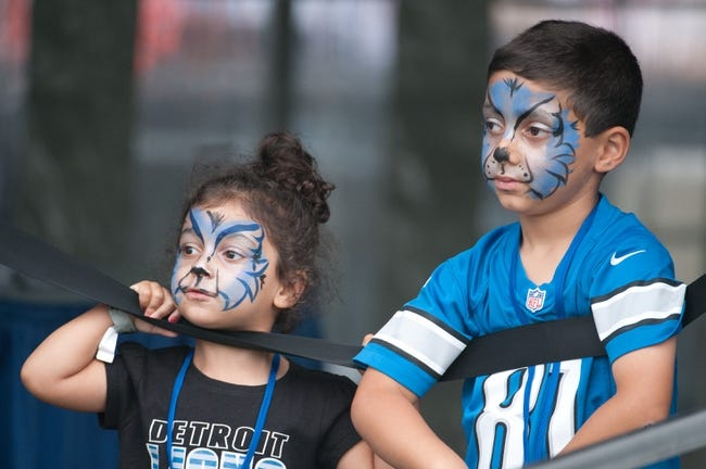 Aug 2, 2014; Detroit, MI, USA; Young Detroit Lions fans look on during training camp at the Detroit Lions training facility. Mandatory Credit: Tim Fuller-USA TODAY Sports