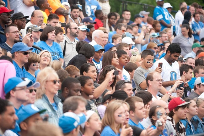 Aug 2, 2014; Detroit, MI, USA; Detroit Lions fans watch during training camp at the Lions training facility. Mandatory Credit: Tim Fuller-USA TODAY Sports