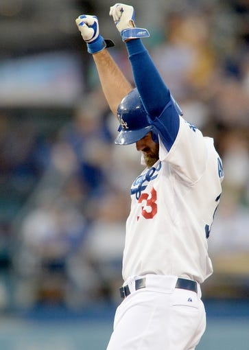 Aug 2, 2014; Los Angeles, CA, USA;  Los Angeles Dodgers center fielder Scott Van Slyke (33) raises his arms after a double in the fourth inning of the game against the Chicago Cubs at Dodger Stadium. Mandatory Credit: Jayne Kamin-Oncea-USA TODAY Sports