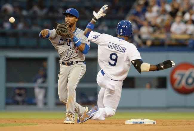 Aug 2, 2014; Los Angeles, CA, USA;  Chicago Cubs second baseman Arismendy Alcantara (7) throws to first as Los Angeles Dodgers second baseman Dee Gordon (9) is out on a double play in the fourth inning of the game at Dodger Stadium. Mandatory Credit: Jayne Kamin-Oncea-USA TODAY Sports