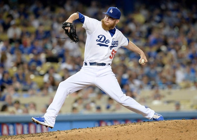 Aug 2, 2014; Los Angeles, CA, USA;  Los Angeles Dodgers relief pitcher J.P. Howell (56) in the eighth inning of the game against the Chicago Cubs at Dodger Stadium. Mandatory Credit: Jayne Kamin-Oncea-USA TODAY Sports