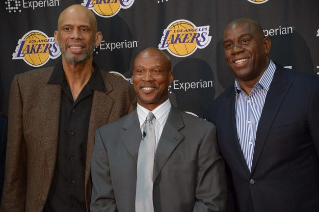 Jul 29, 2014; El Segundo, CA, USA; Byron Scott (center) poses with Kareem Abdul-Jabbar (left) and Magic Johnson at press conference to announcee Scott as Los Angeles Lakers coach at Toyota Sports Center. Mandatory Credit: Kirby Lee-USA TODAY Sports
