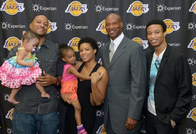 Jul 29, 2014; El Segundo, CA, USA; Byron Scott (second from right) poses with children Thomas Scott (left), LonDen Scott (center) and DaRon Scott (right) and grandchildren at press conference to announcee his hiring as Los Angeles Lakers coach at Toyota Sports Center. Mandatory Credit: Kirby Lee-USA TODAY Sports