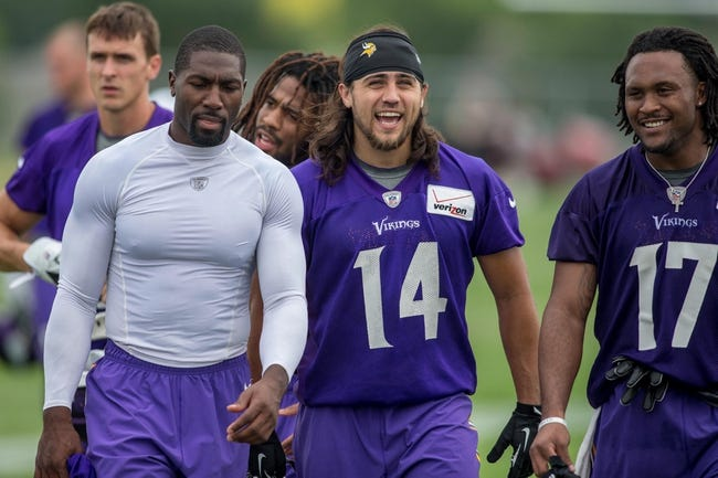 Jul 25, 2014; Mankato, MN, USA; Minnesota Vikings wide receiver Greg Jennings (15) and wide receiver Erik Lora (14) leave the field at training camp at Minnesota State University. Mandatory Credit: Bruce Kluckhohn-USA TODAY Sports
