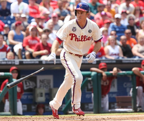 Jul 27, 2014; Philadelphia, PA, USA; Philadelphia Phillies second baseman Chase Utley (26) tosses his bat after drawing a walk in a game against the Arizona Diamondbacks at Citizens Bank Park. The Phillies won 4-2. Mandatory Credit: Bill Streicher-USA TODAY Sports