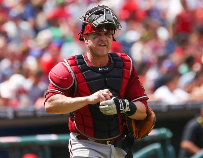 Jul 27, 2014; Philadelphia, PA, USA; Arizona Diamondbacks catcher Miguel Montero (26) lifts his mask and walks to the plate to start the fourth inning of a game against the Philadelphia Phillies at Citizens Bank Park. The Phillies won 4-2. Mandatory Credit: Bill Streicher-USA TODAY Sports