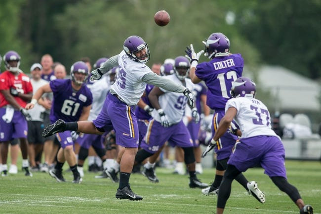 Jul 25, 2014; Mankato, MN, USA; A pass gets past Minnesota Vikings defensive end Scott Crichton (95) in drills at training camp at Minnesota State University. Mandatory Credit: Bruce Kluckhohn-USA TODAY Sports