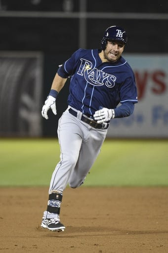 August 4, 2014; Oakland, CA, USA; Tampa Bay Rays right fielder Kevin Kiermaier (39) runs to third base on a triple against the Oakland Athletics during the fifth inning at O.co Coliseum. Mandatory Credit: Kyle Terada-USA TODAY Sports