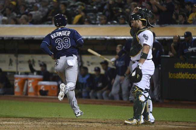 August 4, 2014; Oakland, CA, USA; Tampa Bay Rays right fielder Kevin Kiermaier (39) scores on a RBI-single by center fielder Desmond Jennings (8, not pictured) against Oakland Athletics catcher Derek Norris (36, right) during the fifth inning at O.co Coliseum. Mandatory Credit: Kyle Terada-USA TODAY Sports