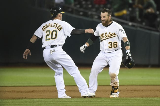 August 4, 2014; Oakland, CA, USA; Oakland Athletics catcher Derek Norris (36) celebrates with third baseman Josh Donaldson (20) after Norris hit a game-winning RBI-single scoring center fielder Sam Fuld (23, not pictured) against the Tampa Bay Rays during the tenth inning at O.co Coliseum. The Athletics defeated the Rays 3-2. Mandatory Credit: Kyle Terada-USA TODAY Sports