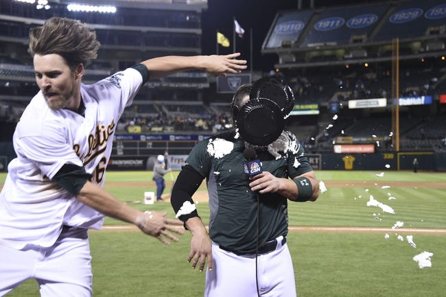 August 4, 2014; Oakland, CA, USA; Oakland Athletics right fielder Josh Reddick (16, left) pies catcher Derek Norris (36, right) after Norris hit the game-winning RBI-single during the 10th inning against the Tampa Bay Rays at O.co Coliseum. The Athletics defeated the Rays 3-2. Mandatory Credit: Kyle Terada-USA TODAY Sports