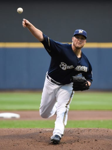 Aug 5, 2014; Milwaukee, WI, USA;  Milwaukee Brewers pitcher Jimmy Nelson (52) pitches in the first inning against the San Francisco Giants at Miller Park. Mandatory Credit: Benny Sieu-USA TODAY Sports