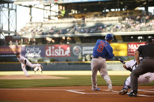 Aug 5, 2014; Denver, CO, USA; Chicago Cubs second baseman Javier Baez (9) at bat during the first inning against the Colorado Rockies at Coors Field. Mandatory Credit: Chris Humphreys-USA TODAY Sports