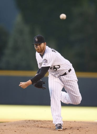 Aug 5, 2014; Denver, CO, USA; Colorado Rockies pitcher Brett Anderson (30) delivers a pitch during the first inning against the Chicago Cubs at Coors Field.Mandatory Credit: Chris Humphreys-USA TODAY Sports