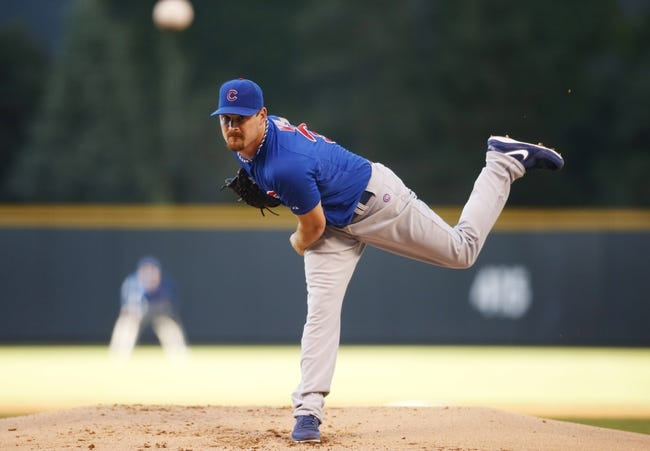 Aug 5, 2014; Denver, CO, USA; Chicago Cubs starting pitcher Travis Wood (37) delivers a pitch during the first inning against the Colorado Rockies at Coors Field.  Mandatory Credit: Chris Humphreys-USA TODAY Sports