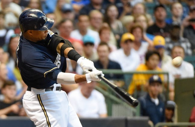 Aug 5, 2014; Milwaukee, WI, USA; Milwaukee Brewers center fielder Carlos Gomez (27) hits a 2-run homer in the third inning against the San Francisco Giants at Miller Park. Mandatory Credit: Benny Sieu-USA TODAY Sports