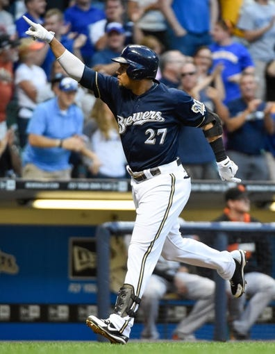 Aug 5, 2014; Milwaukee, WI, USA; Milwaukee Brewers center fielder Carlos Gomez (27) reacts after hitting a 2-run homer in the third inning against the San Francisco Giants at Miller Park. Mandatory Credit: Benny Sieu-USA TODAY Sports