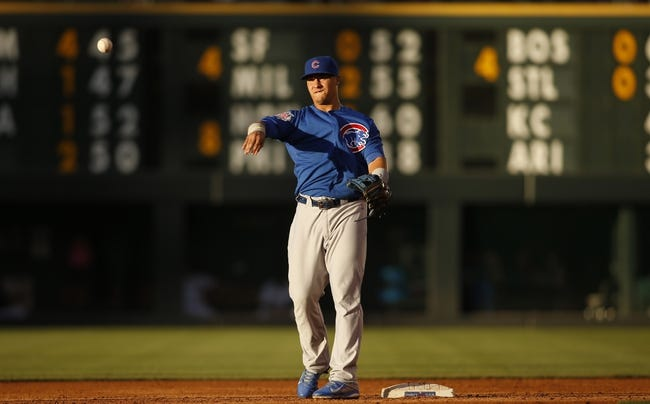 Aug 5, 2014; Denver, CO, USA; Chicago Cubs second baseman Javier Baez (9) warms up during the third inning against the Colorado Rockies at Coors Field. Mandatory Credit: Chris Humphreys-USA TODAY Sports