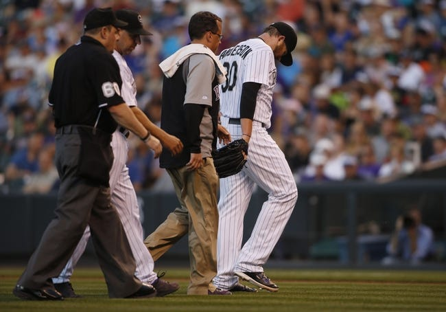 Aug 5, 2014; Denver, CO, USA; Colorado Rockies pitcher Brett Anderson (30) leaves the game during the fourth inning against the Chicago Cubs at Coors Field.Mandatory Credit: Chris Humphreys-USA TODAY Sports
