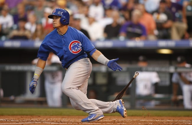 Aug 5, 2014; Denver, CO, USA; Chicago Cub Javier Baez (9) grounds out during the fourth inning against the Colorado Rockies at Coors Field. Mandatory Credit: Chris Humphreys-USA TODAY Sports
