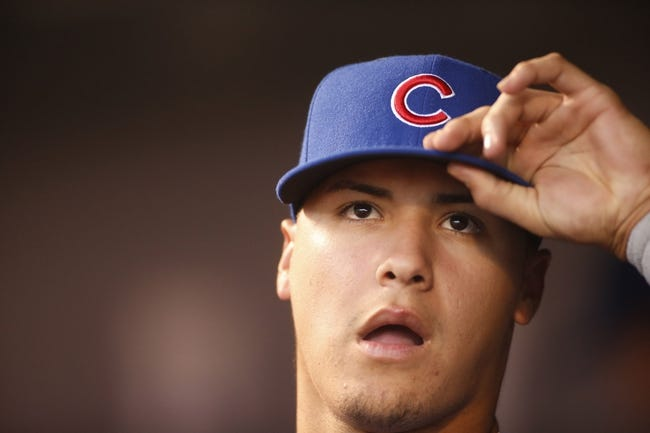 Aug 5, 2014; Denver, CO, USA; Chicago Cub second baseman Javier Baez (9) looks on during the fifth inning against the Colorado Rockies at Coors Field. Mandatory Credit: Chris Humphreys-USA TODAY Sports