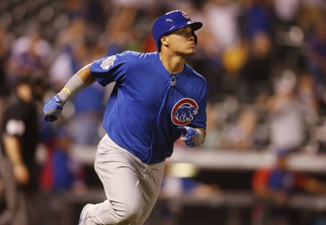 Aug 5, 2014; Denver, CO, USA; Chicago Cubs second baseman Javier Baez (9) watches his game winning home run ball as he runs the bases during the twelfth inning against the Colorado Rockies at Coors Field. The Cubs won 6-5.  Mandatory Credit: Chris Humphreys-USA TODAY Sports