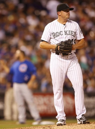 Aug 5, 2014; Denver, CO, USA; Colorado Rockies pitcher Rex Brothers (49) reacts during the seventh inning against the Colorado Rockies at Coors Field. The Cubs won 6-5 in twelve innings.  Mandatory Credit: Chris Humphreys-USA TODAY Sports