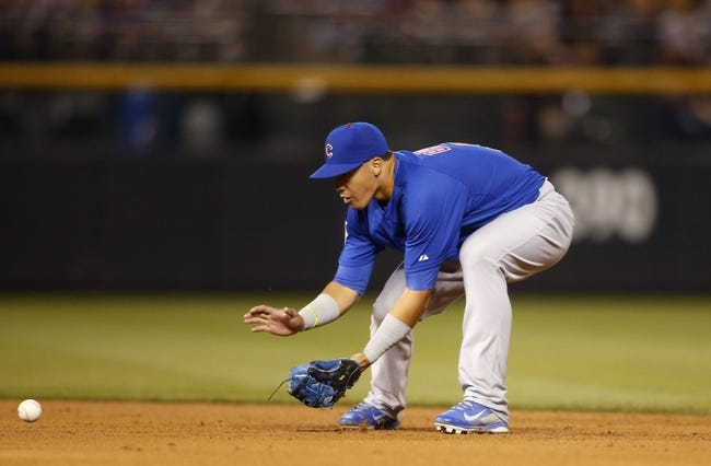Aug 5, 2014; Denver, CO, USA; Chicago Cubs second baseman Javier Baez (9) fields a ground ball during the seventh inning against the Colorado Rockies at Coors Field. The Cubs won 6-5 in twelve innings.  Mandatory Credit: Chris Humphreys-USA TODAY Sports