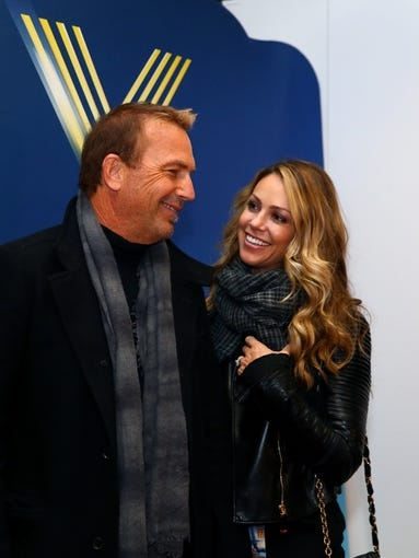 Feb 2, 2014; East Rutherford, NJ, USA; Movie actor Kevin Costner (left) and Christine Baumgartner before Super Bowl XLVIII between the Seattle Seahawks and the Denver Broncos at MetLife Stadium.  Mandatory Credit: Mark J. Rebilas-USA TODAY Sports