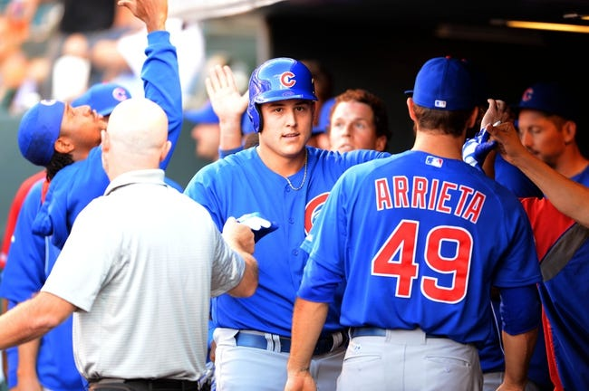 Aug 6, 2014; Denver, CO, USA; Chicago Cubs left fielder Chris Coghlan (8) celebrates after scoring in the first inning against the Colorado Rockies at Coors Field. Mandatory Credit: Ron Chenoy-USA TODAY Sports