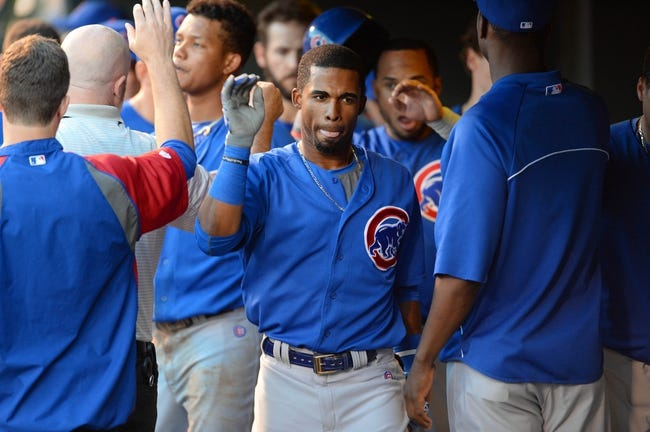Aug 6, 2014; Denver, CO, USA; Chicago Cubs second baseman Arismendy Alcantara (7) celebrates his two run home run in the fourth inning against the Colorado Rockies at Coors Field. Mandatory Credit: Ron Chenoy-USA TODAY Sports