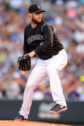 Aug 6, 2014; Denver, CO, USA; Colorado Rockies starting pitcher Jordan Lyles (24) delivers a pitch in the fourth inning against the Chicago Cubs at Coors Field. Mandatory Credit: Ron Chenoy-USA TODAY Sports