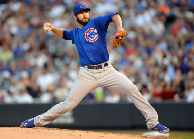 Aug 6, 2014; Denver, CO, USA; Chicago Cubs starting pitcher Jake Arrieta (49) delivers a pitch in the fourth inning against the Colorado Rockies at Coors Field. Mandatory Credit: Ron Chenoy-USA TODAY Sports