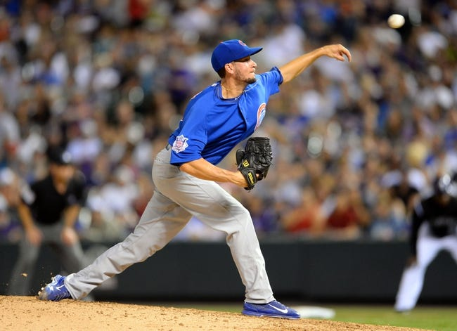 Aug 6, 2014; Denver, CO, USA; Chicago Cubs relief pitcher Chris Rusin (18) delivers a pitch in the seventh inning against the Colorado Rockies at Coors Field. Mandatory Credit: Ron Chenoy-USA TODAY Sports