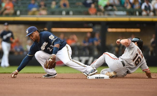 Aug 7, 2014; Milwaukee, WI, USA;  Milwaukee Brewers second baseman Rickie Weeks (23) reaches for a low relay throw to force out San Francisco Giants center fielder Angel Pagan (16) in the first inning at Miller Park. Mandatory Credit: Benny Sieu-USA TODAY Sports