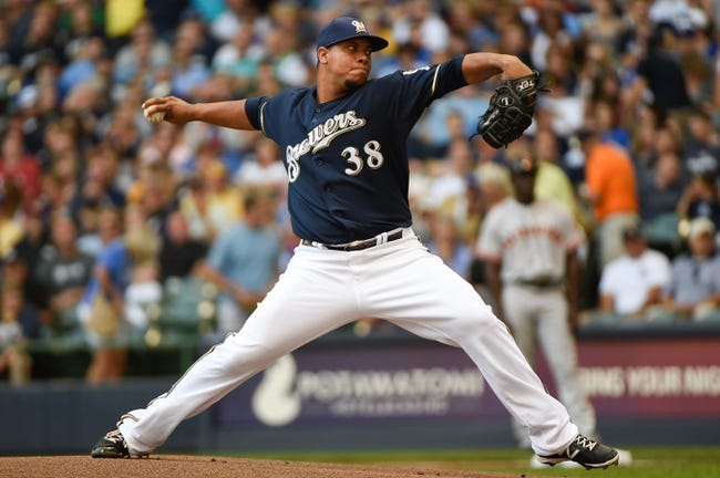 Aug 7, 2014; Milwaukee, WI, USA;  Milwaukee Brewers pitcher Wily Peralta (38) pitches in the first inning against the San Francisco Giants at Miller Park. Mandatory Credit: Benny Sieu-USA TODAY Sports