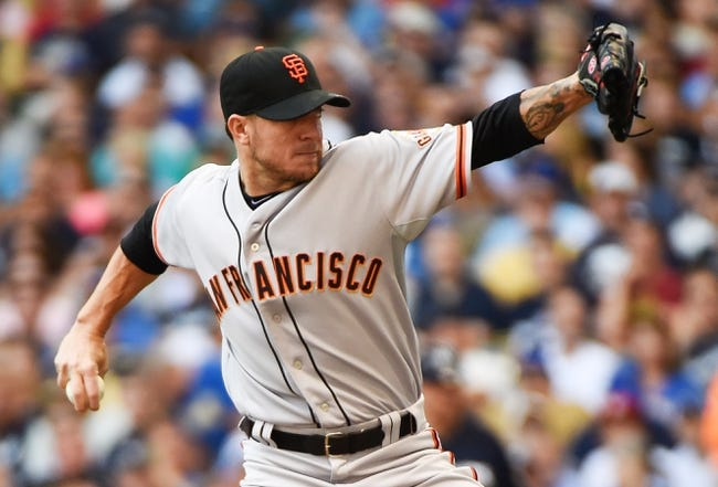 Aug 7, 2014; Milwaukee, WI, USA;  San Francisco Giants pitcher Jake Peavy (43) pitches in the first inning against the Milwaukee Brewers at Miller Park. Mandatory Credit: Benny Sieu-USA TODAY Sports
