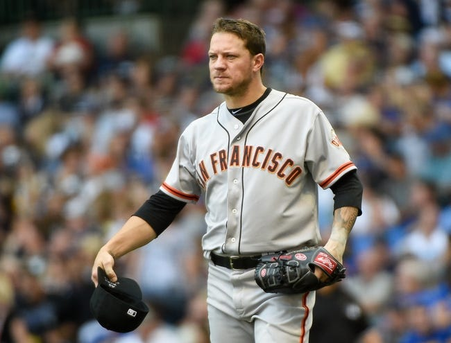 Aug 7, 2014; Milwaukee, WI, USA;  San Francisco Giants pitcher Jake Peavy (43) gets ready to pitch before the fourth inning against the Milwaukee Brewers at Miller Park. Mandatory Credit: Benny Sieu-USA TODAY Sports