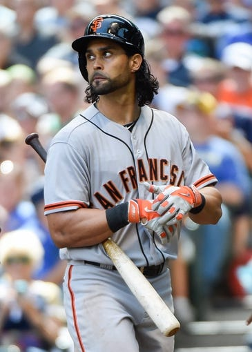 Aug 7, 2014; Milwaukee, WI, USA;  San Francisco Giants center fielder Angel Pagan (16) reacts after being called out on strikes in the seventh inning against the Milwaukee Brewers at Miller Park. Mandatory Credit: Benny Sieu-USA TODAY Sports